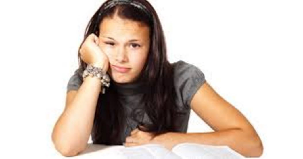"Barely Adequate Parenting magazine ""back to school"" issue with bored-looking teenage girl."