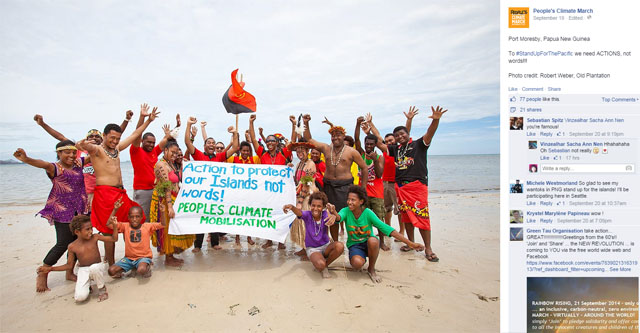 Photo People's Climate March: People on beach in new Guinea holding sign Action to protect our islands not words!